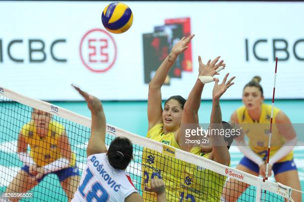 Natalia Pereira and Ana Beatriz Correa of Brazil in action during the semi final match between Brazil and Serbia during 2017 Nanjing FIVB World Grand...