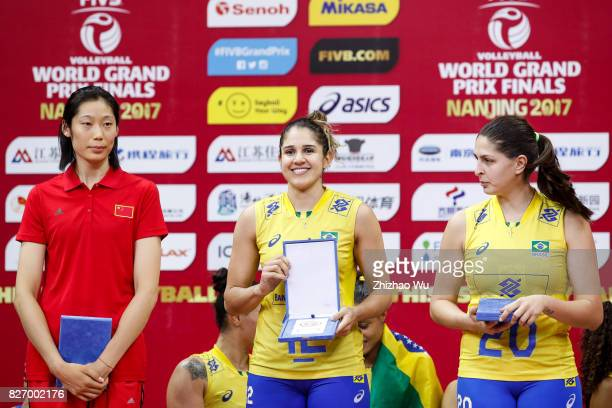 Natalia Pereira and Ana Beatriz Correa of Brazil#2 Zhu Ting of China celebrate during the award ceremony 2017 Nanjing FIVB World Grand Prix Finals...