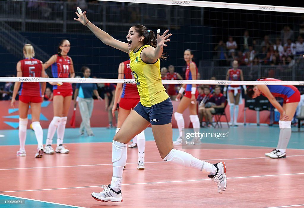 Natalia Pereira #12 of Brazil celebrates the win over Russia during Women's Volleyball quarterfinals on Day 11 of the London 2012 Olympic Games at Earls Court on August 7, 2012 in London, England.