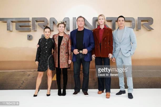 Natalia Reyes Linda Hamilton Arnold Schwarzenegger Mackenzie Davis and Gabriel Luna pose at a photocall for Terminator Dark Fate at the Mandarin...