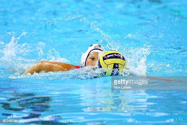 Natalia Shepelina of Russia moves the ball while taking on Italy during their preliminary water polo match at the Ying Tung Natatorium on Day 3 of...