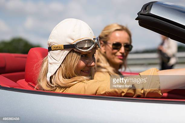 Natalia Sklenarikova and her sister Adriana Karembeu are seen in the Ferrari California number 2 at the Circuit Maurice Tissandier during the 15th...