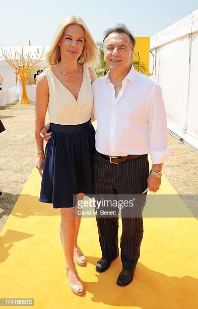 Natalia Traxel and Raymond Blanc attend the Veuve Clicquot Gold Cup Final at Cowdray Park Polo Club on July 21 2013 in Midhurst England