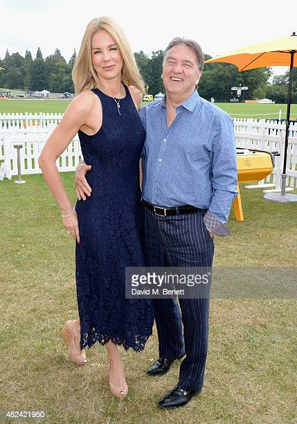 Natalia Traxel and Raymond Blanc attend the Veuve Clicquot Gold Cup Final at Cowdray Park Polo Club on July 20 2014 in Midhurst England