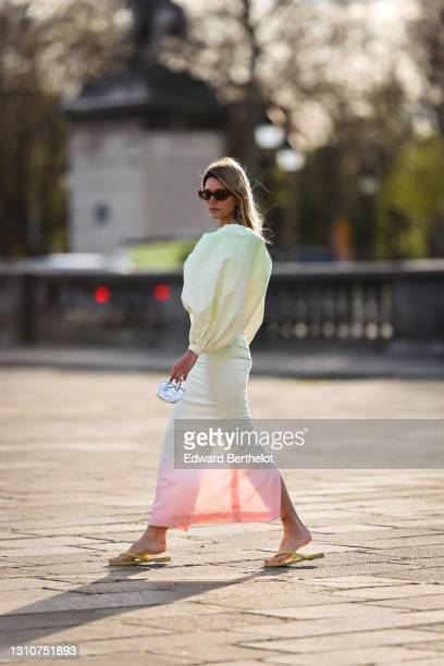Natalia Verza @mascarada.paris wears sunglasses, a pastel colored green and pink oversized tie and dye midi dress with low-neck and puff large...