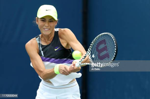 Natalia Vikhlyantseva of Russia returns a shot against Julia Goerges of Germany during their Women's Singles first round match on day two of the 2019...