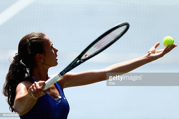 Natalia Vikhlyantseva of Russia serves to Catherine Bellis of the United States during their junior girls' singles second round match on Day Nine of...