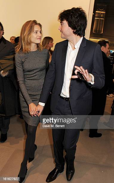 Natalia Vodianova and Antoine Arnault attend a private view of 'Mat Collishaw This Is Not An Exit' at Blaine/Southern Gallery on February 13 2013 in...
