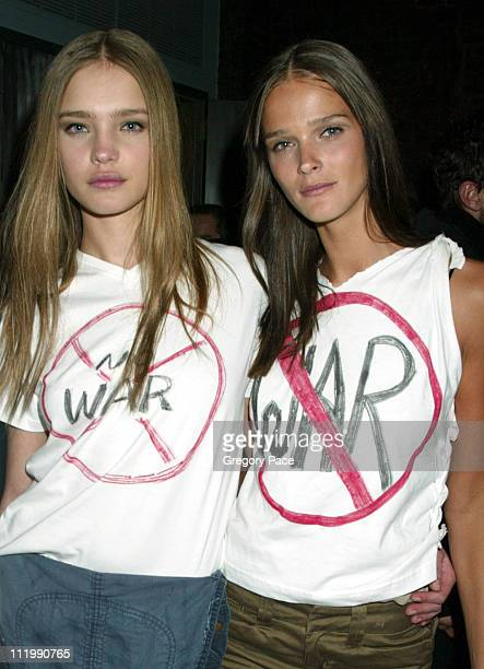 Natalia Vodianova and Carmen Kass Calvin Klein models backstage after the show and wearing antiwar Tshirts