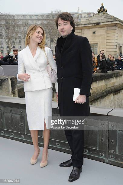 Natalia Vodianova and companion Antoine Arnault arrive to atttend the Christian Dior Fall/Winter 2013 ReadytoWear show as part of Paris Fashion Week...