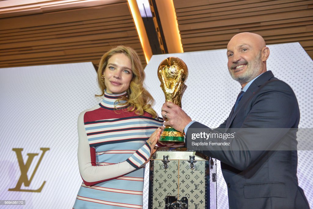 Natalia Vodianova and French Former player Franck Leboeuf with the FIFA World Cup Trophy during the Press Conference of Louis Vuitton at Louis Vuitton on May 17, 2018 in Paris, France.