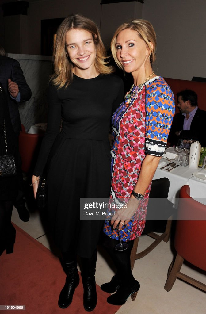 Natalia Vodianova (L) and guest attend a private dinner hosted by Lucy Yeomans celebrating Jason Brooks at Cafe Royal on February 12, 2013 in London, England.