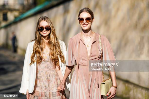 Natalia Vodianova and her half sister Kristina Kusakina are seen outside Dior during Paris Fashion Week Womenswear Fall/Winter 2019/2020 on February...