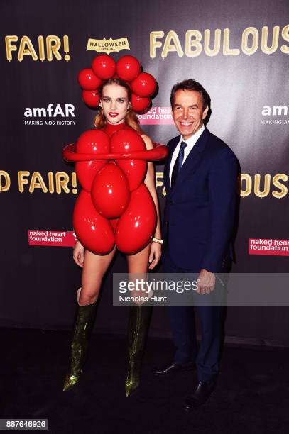 Natalia Vodianova and Jeff Koons attend the 2017 amfAR The Naked Heart Foundation Fabulous Fund Fair at Skylight Clarkson Sq on October 28 2017 in...