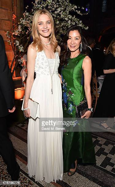 Natalia Vodianova and Michelle Yeoh at the inaugural Walkabout Foundation gala drinks by Boujis London at Natural History Museum on June 27 2015 in...