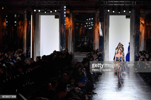 Natalia Vodianova and models walk the runway at the Versace show during Milan Fashion Week Fall/Winter 2018/19 on February 23 2018 in Milan Italy