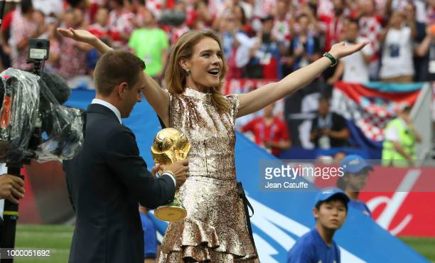 Natalia Vodianova and Philipp Lahm of Germany present the trophy before the 2018 FIFA World Cup Russia Final match between France and Croatia at...