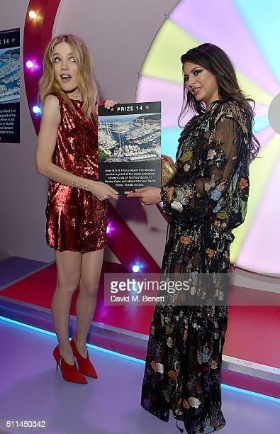 Natalia Vodianova and prize winner at The Naked Heart Foundation's Fabulous Fund Fair in London at Old Billingsgate Market on February 20 2016 in...
