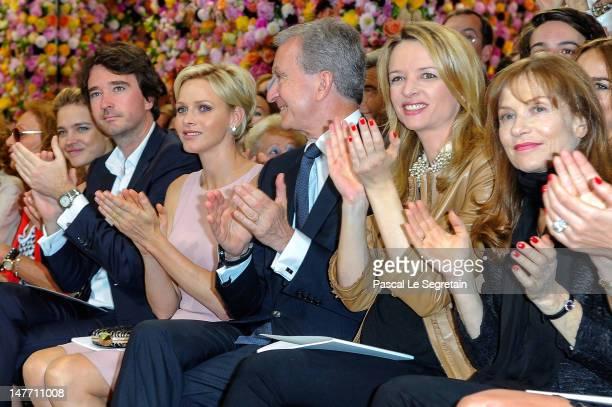 Natalia Vodianova Antoine Arnault Princess Charlene Bernard Arnault Delphine Arnault and Isabelle Huppert applaud after the Christian Dior...