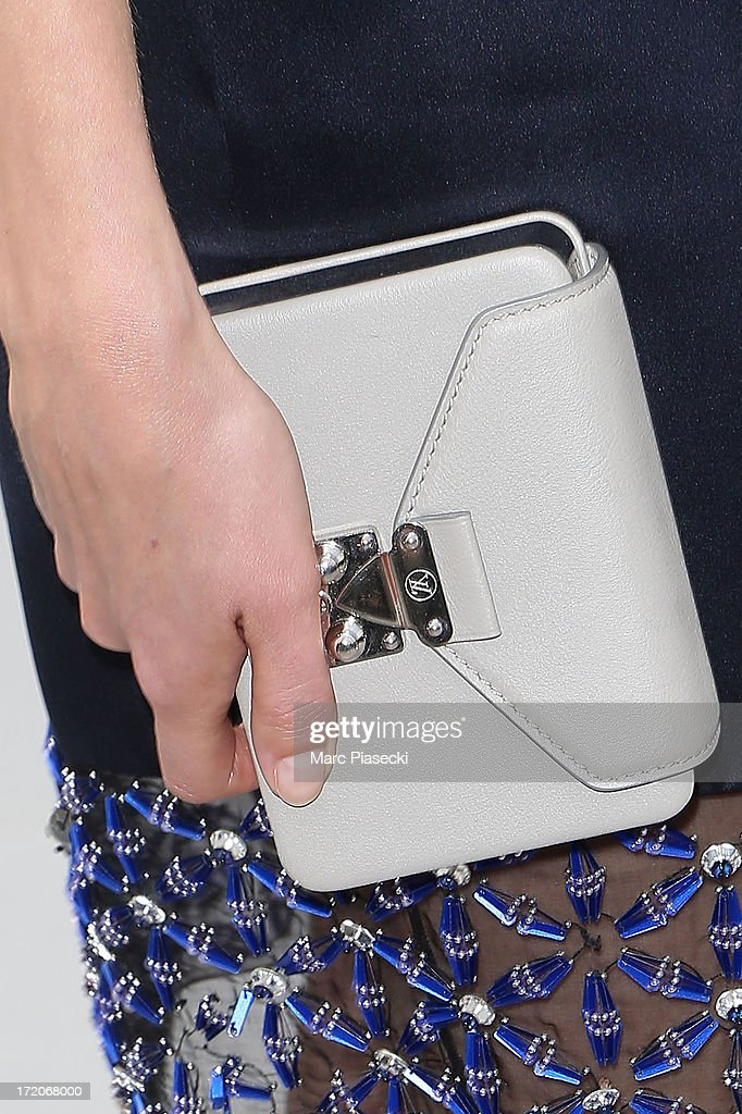 Natalia Vodianova (clutch bag detail) arrives to attend the Christian Dior show as part of Paris Fashion Week Haute Couture Fall/Winter 2013-2014 at on July 1, 2013 in Paris, France.