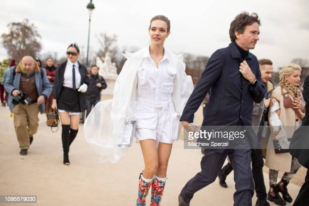 Natalia Vodianova is seen attending Louis Vuitton during Men's Paris Fashion Week AW19 wearing allwhite outfit with colorful Louis Vuitton boots on...