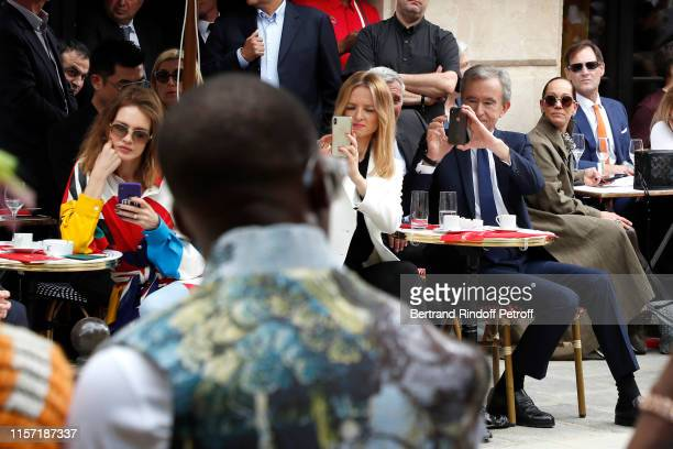Natalia Vodianova, Louis Vuitton's executive vice president Delphine Arnault and Owner of LVMH Luxury Group Bernard Arnault attend the Louis Vuitton...