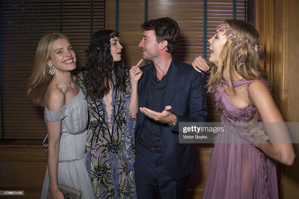 Natalia Vodianova, Mariacarla Boscono, Antoine Arnault and Karlie Kloss attend the amfAR dinner at the Pavillon LeDoyen during the Paris Fashion Week Haute Couture on July 5, 2015 in Paris, France.