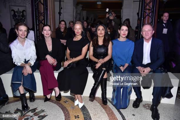 Natalia Vodianova Marie Agnes Gillot Pamela Anderson Salma Hayek Charlotte Casiraghi and FrancoisHenri Pinault attend the Stella McCartney show as...