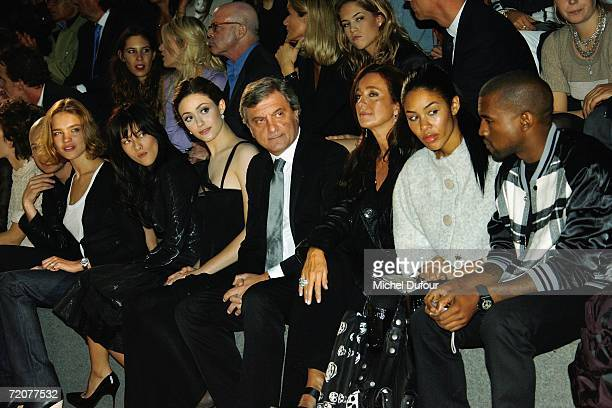 Natalia Vodianova Mylene Jampanoi Emmy Rossum Sidney Toledano his wife and Kanye West attend the Christian Dior Fashion Show as part of Paris Fashion...