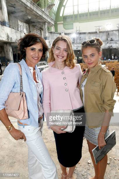 Natalia Vodianova stands between Ines de La Fressange and her daughter Violette d'Urso attend the Chanel show as part of Paris Fashion Week...