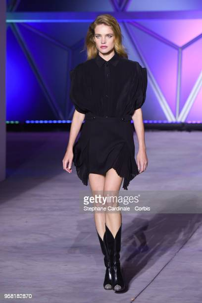 Natalia Vodianova walks the runway at Fashion For Relief Cannes 2018 during the 71st annual Cannes Film Festival at Aeroport Cannes Mandelieu on May...