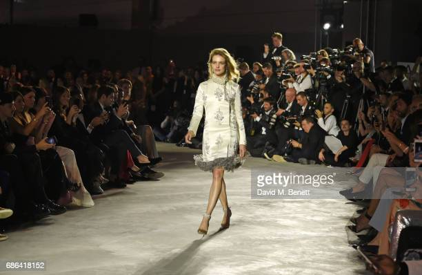 Natalia Vodianova walks the runway at the Fashion for Relief event during the 70th annual Cannes Film Festival at Aeroport Cannes Mandelieu on May 21...