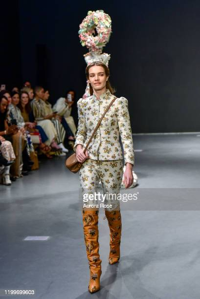 Natalia Vodianova walks the runway at the Tory Burch AW/20 Fashion Show at Sotheby's on February 9, 2020 in New York City.