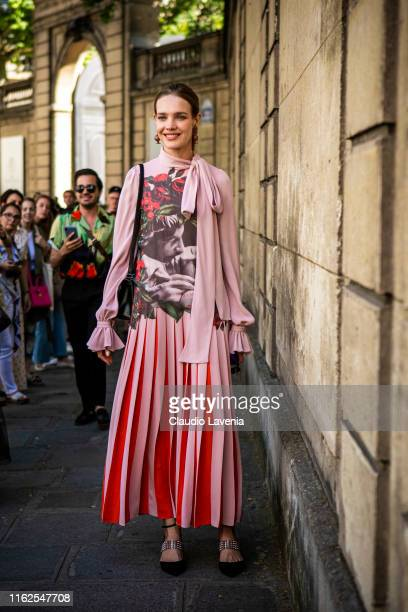 Natalia Vodianova, wearing a pink printed maxi dress, black bag and black shoes, is seen outside VALENTINO show during Paris Fashion Week - Haute...