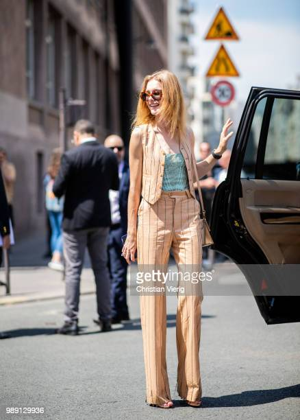 Natalia Vodianova wearing striped suit is seen outside Acne Studios during Paris Fashion Week Haute Couture FW18 on July 1 2018 in Paris France
