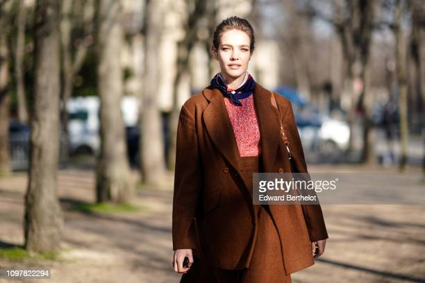Natalia Vodianova wears a brown jacket a brown skirt a scarf during Paris Fashion Week Haute Couture Spring Summer 2020 on January 21 2019 in Paris...