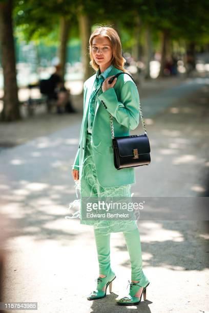 Natalia Vodianova wears a green blazer jacket, outside Berluti, during Paris Fashion Week - Menswear Spring/Summer 2020, on June 21, 2019 in Paris,...