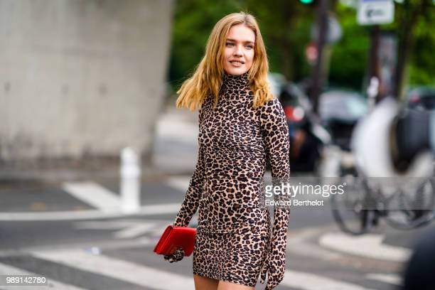 Natalia Vodianova wears a leopard print dress a red clucth outside Vetements during Paris Fashion Week Haute Couture Fall Winter 2018/2019 on July 1...