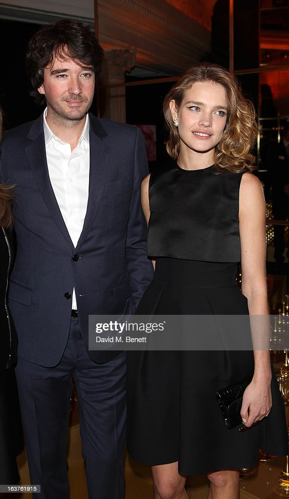 Natalia Vodianova with husband Antoine Arnault attends a photocall to launch Dior at Harrods on March 14, 2013 in London, England.