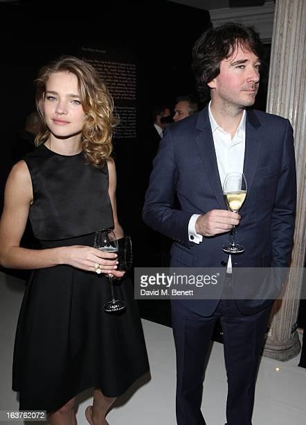 Natalia Vodianova with husband Antoine Arnault attends a photocall to launch Dior at Harrods on March 14 2013 in London England