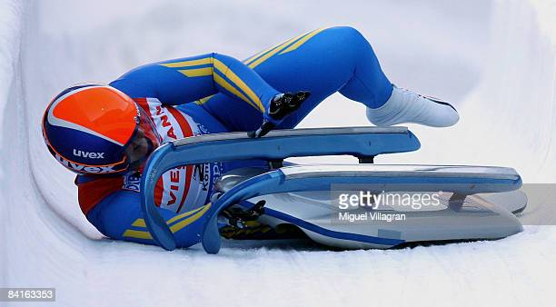 Natalia Yakushenko of the Ukraine crashes in the finish area during the women's single race at the Luge World Cup competition on January 3 2009 in...