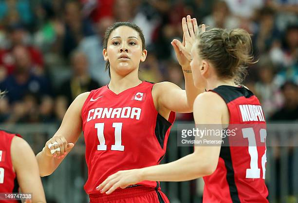 Natalie Achonwa of Canada highfives Lizanne Murphy after scoring against Brazil during the Women's Basketball Preliminary Round match on Day 7 of the...