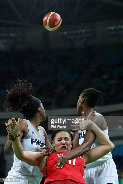 Natalie Achonwa of Canada is squeezed by the French defence during the Women's Quarterfinal match between France and Canada at Carioca Arena 1 on...