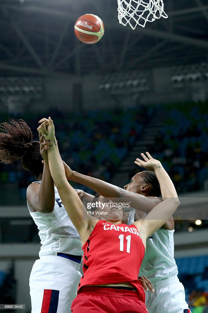 Natalie Achonwa of Canada is squeezed by the French defence during the Women's Quarterfinal match between France and Canada at Carioca Arena 1 on August 16, 2016 in Rio de Janeiro, Brazil.