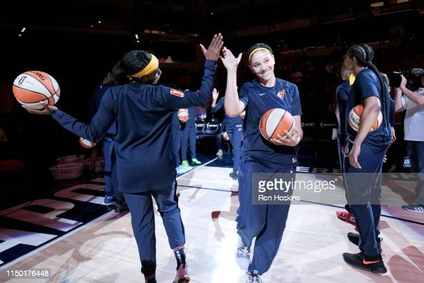 Natalie Achonwa of the Indiana Fever gets introduced before the game against the Chicago Sky on June 15 2019 at the Bankers Life Fieldhouse in...