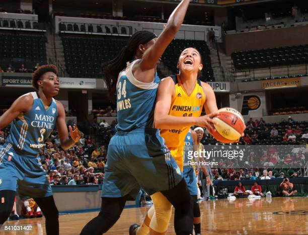 Natalie Achonwa of the Indiana Fever goes for a lay up against the Minnesota Lynx on August 30 2017 at Bankers Life Fieldhouse in Indianapolis...