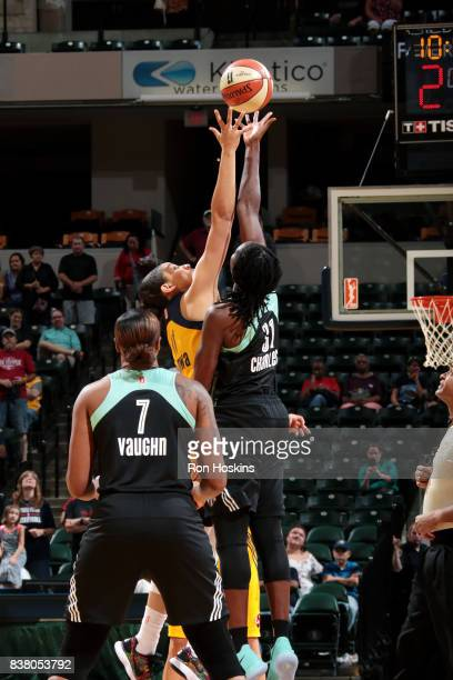 Natalie Achonwa of the Indiana Fever goes for the tip off against Tina Charles of the New York Liberty during a WNBA game on August 23 2017 at...