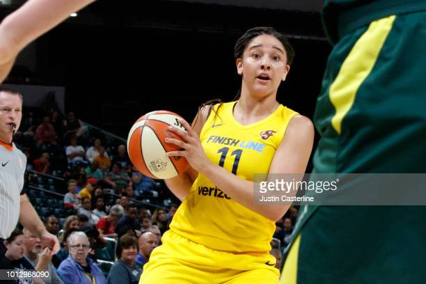 Natalie Achonwa of the Indiana Fever looks to pass the ball during the game against the Seattle Storm on August 7 2018 at Bankers Life Fieldhouse in...
