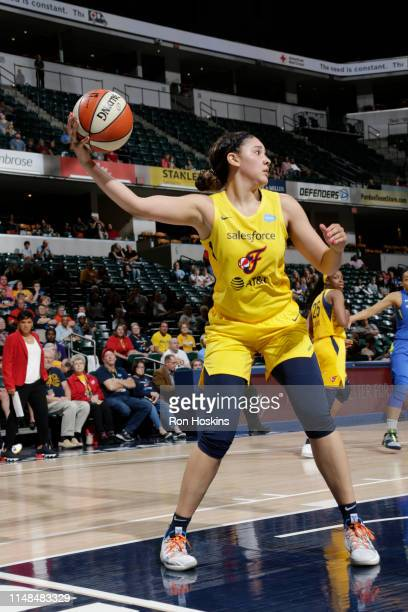 Natalie Achonwa of the Indiana Fever saves the ball during the game against the Dallas Wings on June 7 2019 at the Bankers Life Fieldhouse in...