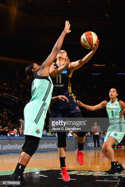 Natalie Achonwa of the Indiana Fever shoots a lay up during the game against the New York Liberty during a WNBA game at Madison Square Garden on...